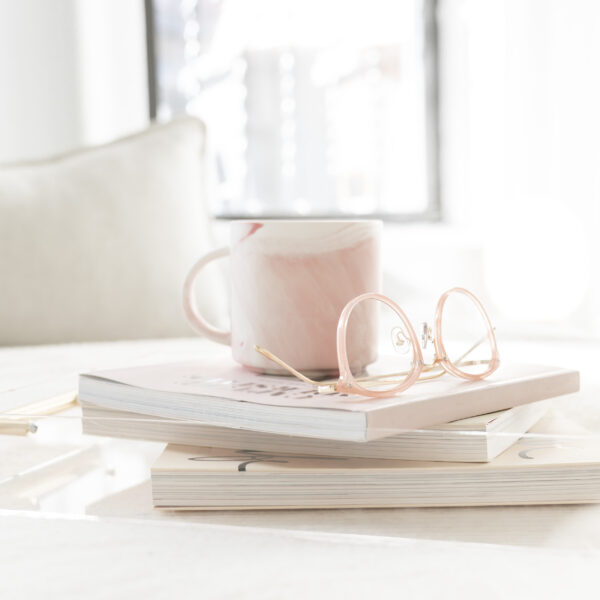 Mug with books and reading glasses